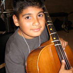 Child playing in El Sistema orchestra